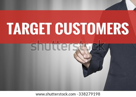 Target Customers word on virtual screen push by business woman red tab - stock photo