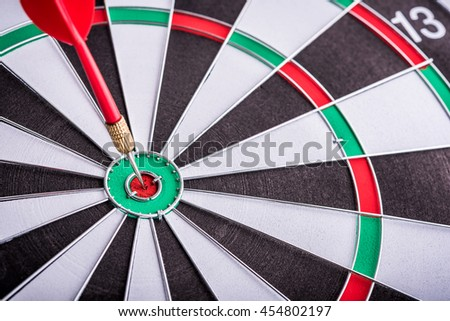 target dart with arrow on dart board, achieve business and target to victory concept