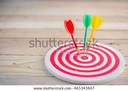 target dart with arrow over wooden background ,abstract background to target marketing concept .