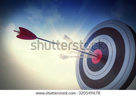 Target hit in the center by arrows - stock photo