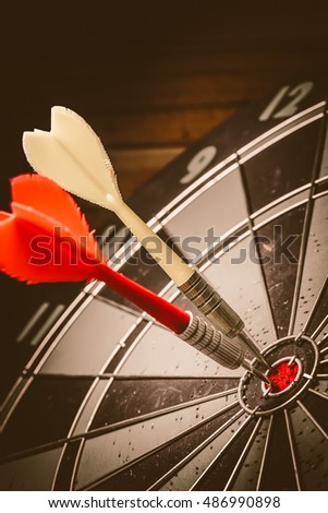 Target marketing or target arrow concept: Bullseye is a target of business. Dart is an opportunity and Dartboard is the target and goal. So both of that represent a challenge. - Vintage Tone