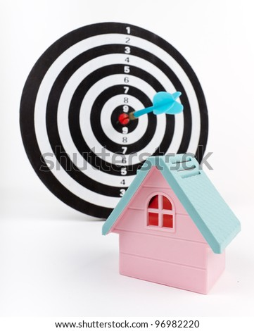 Target Mortgage: Hit the targeted marketing and aim for customers. Darts & House Model - stock photo