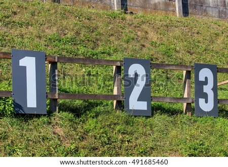 Target numbers on a shooting range in Switzerland. Shooting ranges in Switzerland are common due to the liberal gun laws and strong shooting traditions existing in Switzerland.
