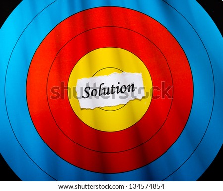 Target on the Best, conceptual word on center of target paper. - stock photo