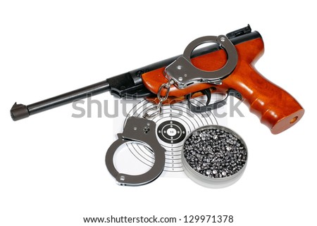 Target shooting equipment with handcuffs isolated over white, clipping path. - stock photo