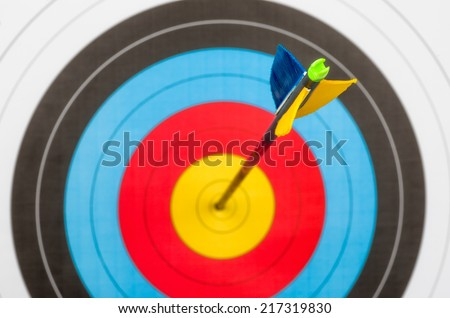 Target with an arrow in the center - stock photo