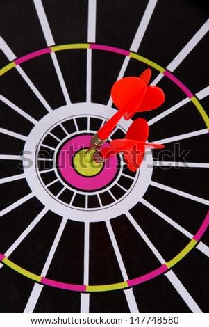 Target with darts close-up - stock photo
