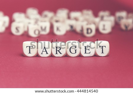 Target word written on wood cube with red background
