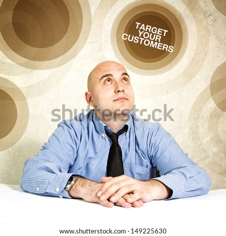 Target your customers; business concept. Businessman looking up.