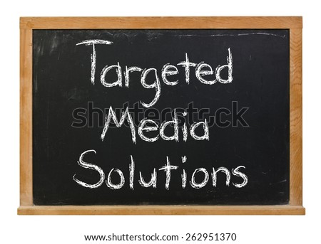 Targeted media solutions written in white chalk on a black chalkboard isolated on white - stock photo