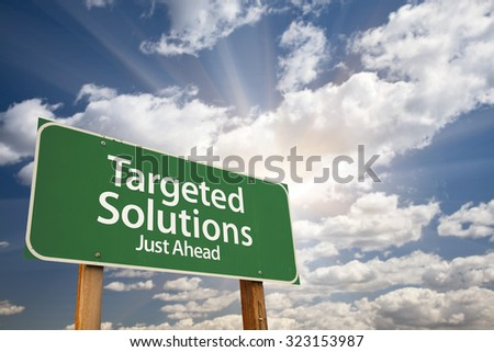 Targeted Solutions Green Road Sign With Dramatic Clouds and Sky.