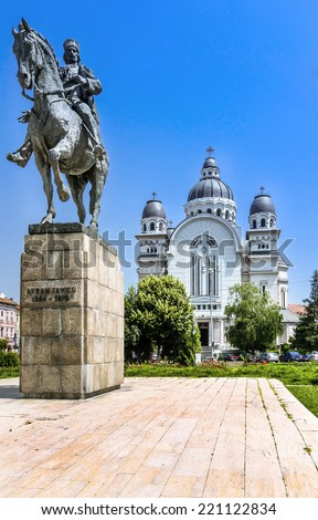 Targu Mures city center with Avram Iancu statue and ortodox church in the Roses Square. - stock photo