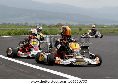 TARGU SECUIESC, ROMANIA - MAY 20: David Dugaesescu, number 401, competes in National Karting Championship, Round 2, on May 20, 2012 in Targu Secuiesc, Romania.