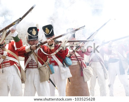 TARIFA, ANDALUSIA, SPAIN - MAY 18 : reenactment of the Siege of Tarifa during the independence wars in Spain in the year 1812 reenacted by british soldiers, shooting, May 18, 2012 in TARIFA, ANDALUSIA, SPAIN - stock photo