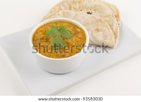Tarka daal and chapati on a white background - stock photo