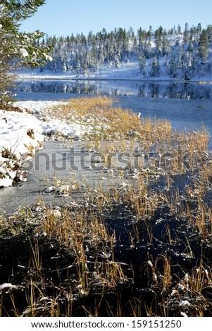 Tarn freezing over - stock photo