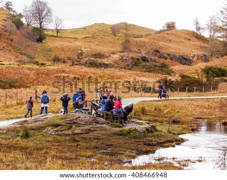 Tarn Hows, Coniston, UK. April 5th 2016. Walkers enjoying the great outdoors at Tarn Hows