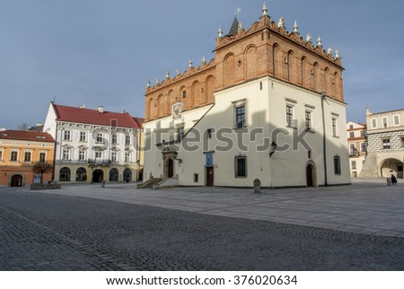 TARNOW, POLAND - FEBRUARY 08, 2016: Old town with 14th century renaissance  Town Hall,  medieval urban layout of street and colorful tenement houses
