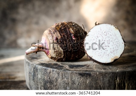 Taro placed on the chopping block in vintage style. - stock photo