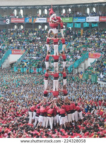 TARRAGONA - OCTOBER 05: castellers making a Castell or Human Tower during the Tarragona Human Tower competition, on October 05, 2014 in Tarragona, Spain.  - stock photo