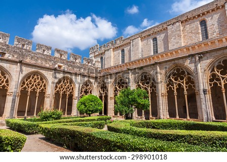 TARRAGONA, SPAIN - JULY 19: Santes Creus Monastery Cloister on July 19, 2015 in Tarragona. The monastery's origins date to 1158 and is part of the Cistercian route in Catalonia. - stock photo