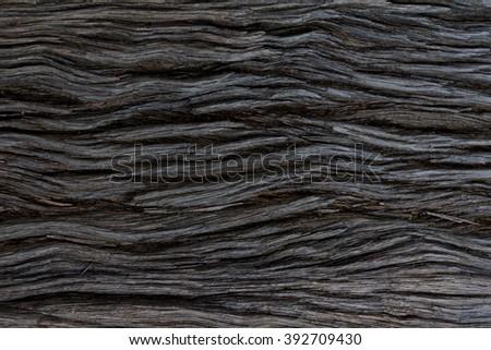 Tarred wooden railway sleeper surface - stock photo
