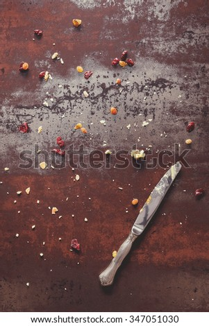 Tart crumbs background. Tart crumbs, dry fruits  and knife on rustic background. End of  party concept. Top view, vintage dark  style, blank space - stock photo