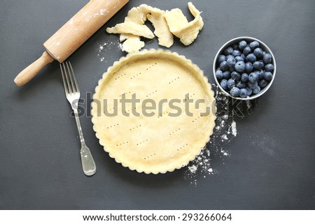 Tart dish with pastry base before being filled to be baked.Top view. - stock photo