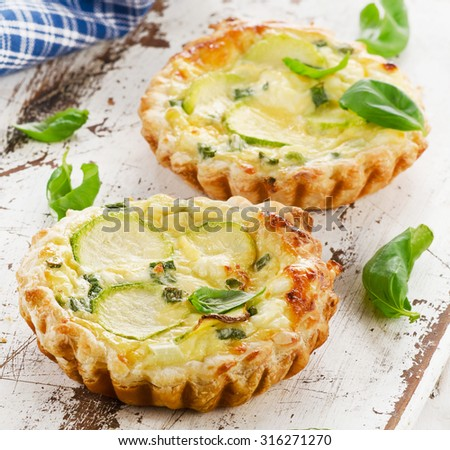 Tart with cheese on a wooden table. Selective focus - stock photo