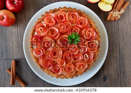 Tart with custard and caramel apples, shortbread dough - stock photo
