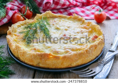 Tart with ham, cheese and eggs - quiche lorraine - stock photo