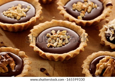 Tart with milk chocolate and nuts - stock photo