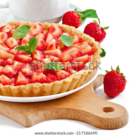 Tart with strawberries and whipped cream decorated with mint leaves - stock photo
