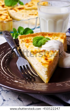 Tart with vegetables and cheese in a plate on a concrete background. Selective focus.