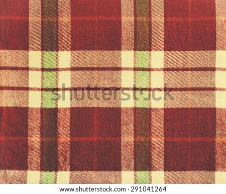 Tartan on Vintage Blanket. Texture of Woolen plaid with purple, beige, yellow color - stock photo