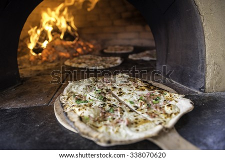 Tarte Flambee, ATraditional French Dish.Fresh Baked In A Wood-Fired Traditional Adobe Oven.( Flame Cake - English, Flammkuchen - German ) - stock photo