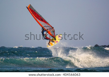 Tartle beach, Mui Ne, Vietnam - December 28, 2015 Windsurfer Igor Yudakov making extreme tricks on the waves