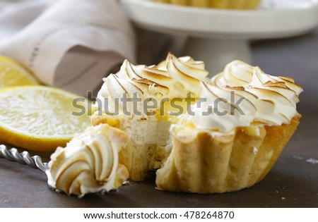 tartlet with lemon cream and meringue on a table