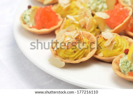 tartlets with cheese sauce and salted salmon - stock photo
