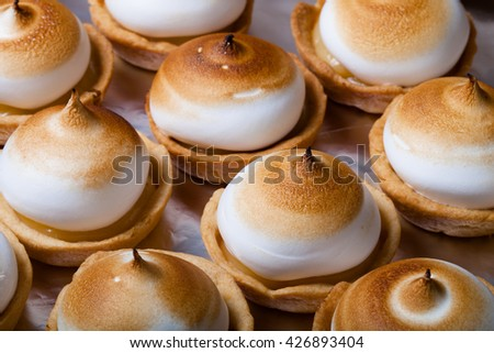 Tartlets with white cream and lemon curd. Shallow depth of field. Selective focus. - stock photo