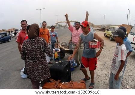 TARTOUS, SYRIA-JULY 17 : Civilians fleeing the war, Syria and Lebanon border on July 17, 2006 in Tartous,Syria.                                 - stock photo