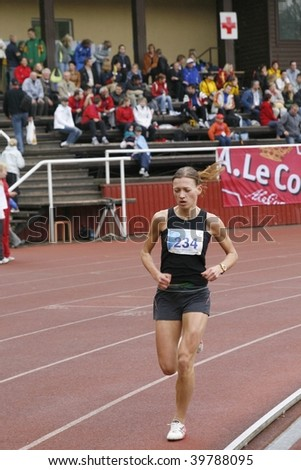TARTU, ESTONIA - MAY 20: Athlete running along the track and taking part in Student Sell Games, organized by Estonian Academic Sports Federation in May 20, 2006 in Tartu, Estonia. - stock photo