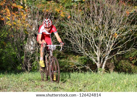 TARTU,ESTONIA-SEPT 30:The cyclist Rein Taaramae, climbs in a muddy competition on September 30 2012 in Tartu, Estonia. Rein Taaramae is an Estonian road bicycle racer for UCI cycling team Cofidis.