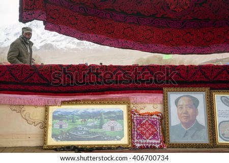 TASHKURGAN, CHINA - MAR 20, 2016: View of souvenirs market during celebration Nowruz holiday near Tashkurgan town Tajik Autonomous County, Xinjiang, China