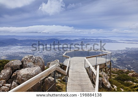 tasmania Mt Wellington equipped lookout for tourists to overlook Hobart Derwent River and the city day time  - stock photo