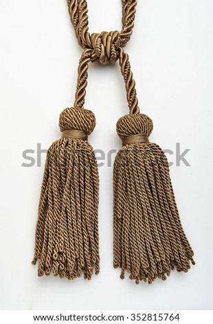 Tassel for curtains on white - stock photo