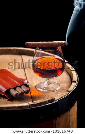 Taste of burnt cigar and cognac - stock photo