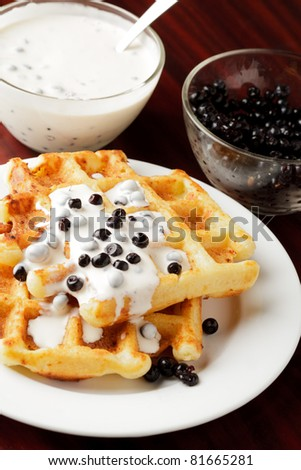 Taste waffle with natural yoghurt and billberies closeup