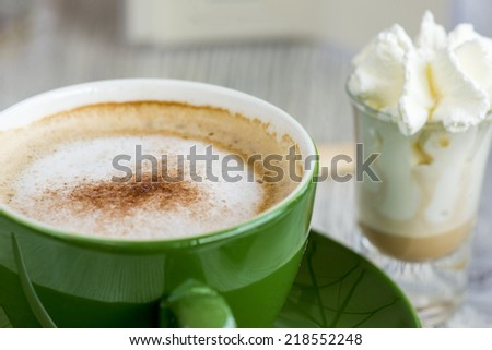 tasteful cup of coffee, with Liqueur and whipcream. close up - stock photo