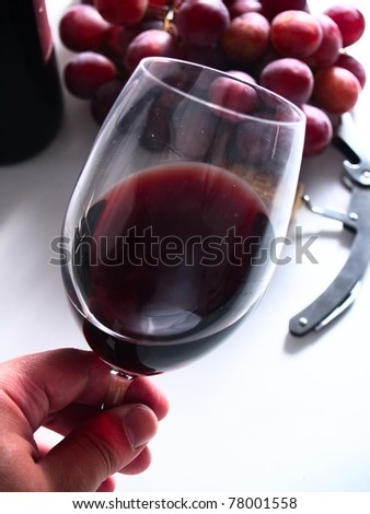 tasting chianti italian reserve wine, with grapes, corkscrew and bottle background